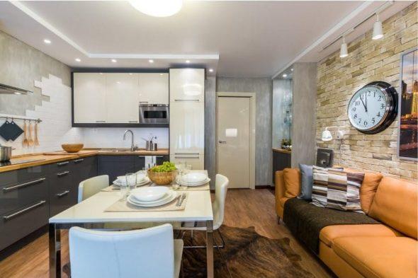 Кожаный диван в интерьере кухни
