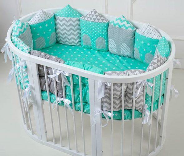 Красивая и удобная овальная кроватка