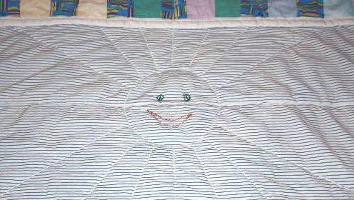 Стежка на детском одеяле